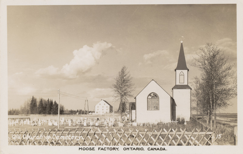 Postcard: showing St. Thomas Anglican Church, Moose Factory, Ontario. Old Hudson Bay Company store in background.