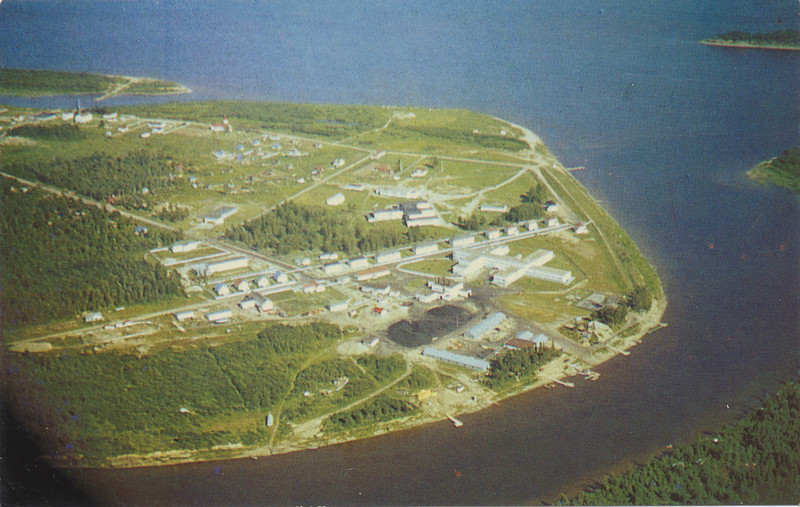 Postcard: Moose Factory: Aerial view. Published by Ontario Northland Transportation Commission. Colour. Unused, Shows upstream end of Moose Factory Island from Hospital to Centennial Museum area. One corner black. Scanned 2009 Nov 29