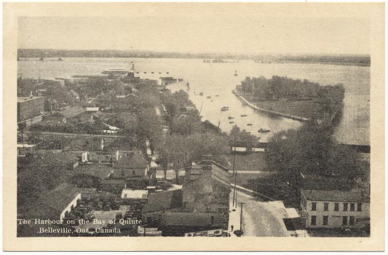 Postcard: Belleville, Ontario. Looking towards harbour, Front Street, Queen Victoria Park, old arena, harbour. Unmailed.