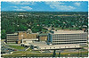 Postcard: Belleville, Ontario. Aerial view of Belleville General Hospital from the south. Bed capacity of 403. Mailed 1971 August 18. Seven cent stamp. Front of card. Queen Elizabeth Public School beyond hospital.