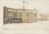 Postcard: Belleville: labelled 1936 Belleville flood on back, shows damage to Belleville Shirt building, view from river or bridge