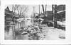 Postcard. Belleville, Ontario. Street scene during flooding marked on back 1936. Traces of album paper on back.