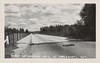 """Postcard:  """"Bridge on Highway No. 11, at Englehart, Ont.""""<br /> View of bridge, with sidewalk on left and railings.<br /> Texaco sign in mid left."""