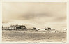Postcard: Moose Factory, Ontario. Wilderness Pictures 24. View from river showing manager's house, staff house, store and other buildings. Not used. Undated.