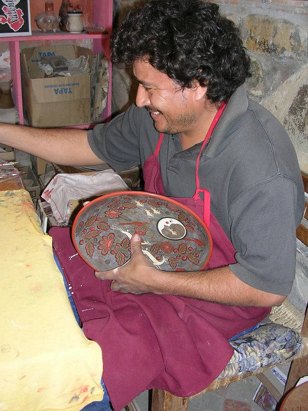 2/16/05 Painting on the designs - an employee in the workshop of Angel Santos, Daniel