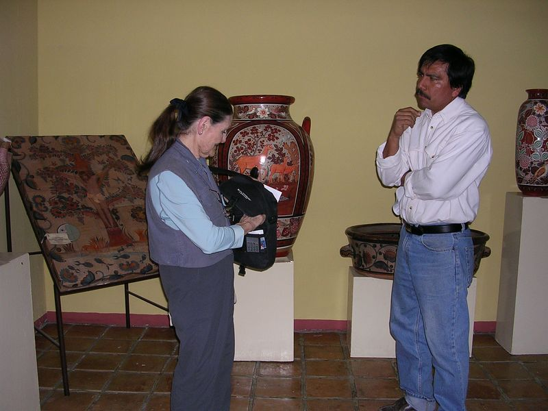 2/15/05 Lenore and Angel Santos at the Casa de Artesanos in Tonala.  Pieces on exhibit are previous contest winners made by local artisans.