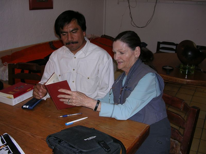 2/15/05 Angel Santos and Lenore look through a book at Jorge Wilmot's apartment in Tonala