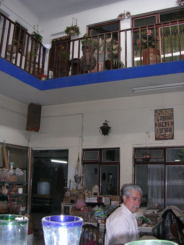 2/21/05 In the Lucano store at 131 Independencia in Tlaquepaque.  The wife of this man is the daughter of Balbino Lucano and together they sell from this store.