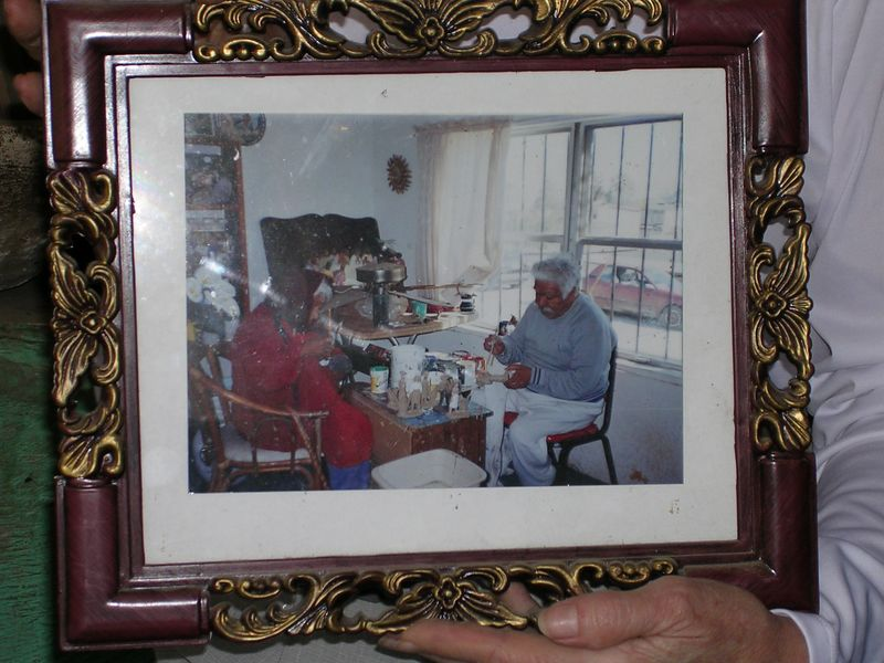 2/16/05 A photo of Maria Rosales with either her husband or son when they were still making pieces.