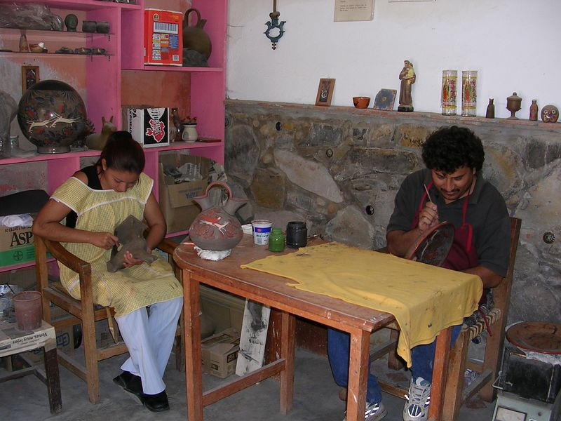 2/16/05 In the workshop of Angel Santos.  The two employees are relatives.  Angel creates the designs and makes the pieces and the others assist with painting.