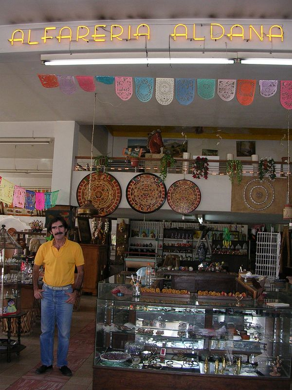 2/19/05 Juan Aldana, Jr. in his shop across from the Parian in Tlaquepaque.  We interviewed his father who started the business in 1931.  He had a workshop in Tonala with 75-100 artisans making pottery and sold it from this shop.