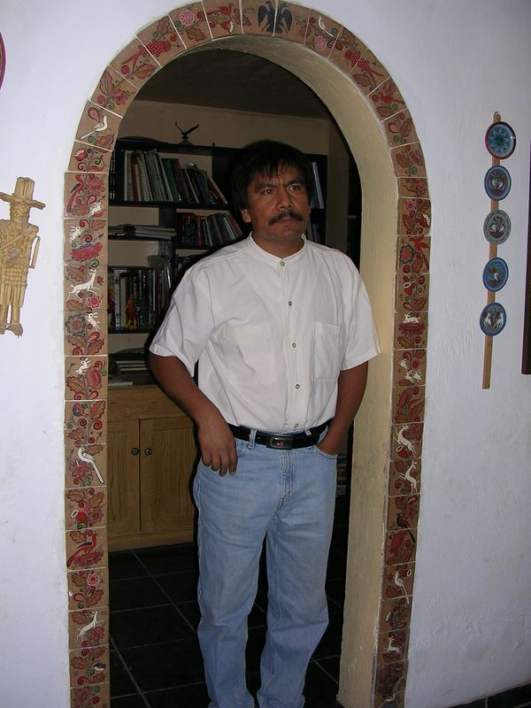 2/16/05 Angel Santos in the doorway of his home (surrounded by his work)
