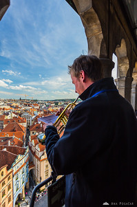 A trumpet player at the top of the Old Town Hall Tower