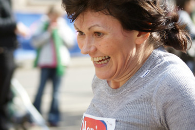 "I stood at the finish waiting for Ron and the Attache to reach me.  The following pictures are entitled ""The Faces of Running"".  Running is such a joy!"