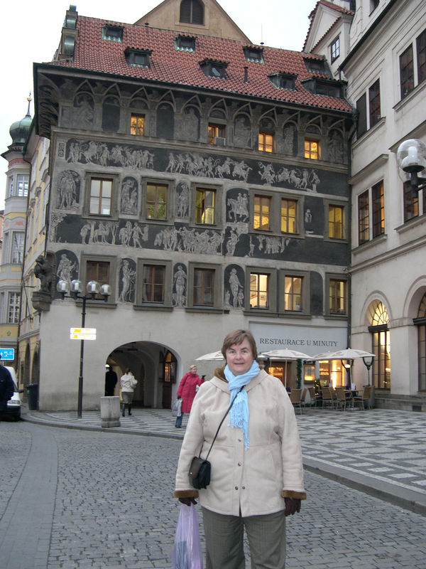 "The ""House of the Minute"" in Old Town Square, with lovely Renaissance style decorations on the outside."
