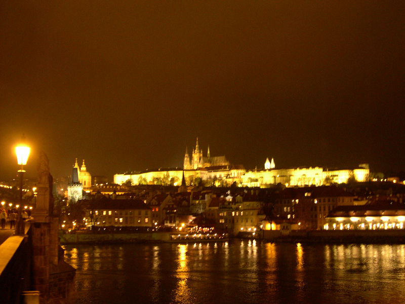 View of Prague Castle at night from Charles Bridge.