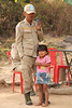 Cambodian soldier with little girl.