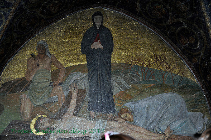 Mosaic showing Christ being nailed to the cross, the 11th Station.