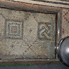Older tile from previous church built by the Crusaders, is on the left, matching newer tile on the right.
