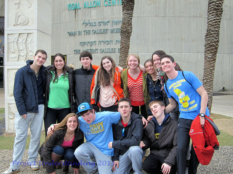 """Group shot in front of """"Man in the Galilee"""" Museum."""
