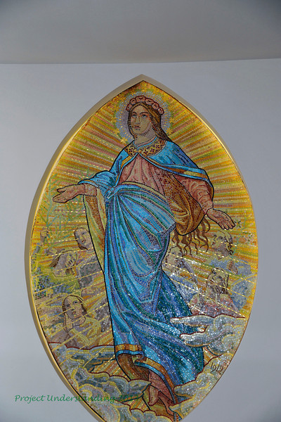 In the lobby area below the church is this mosaic.  It has been repaired and moved inside. The next photo shows what it looked like when it was outside the church.