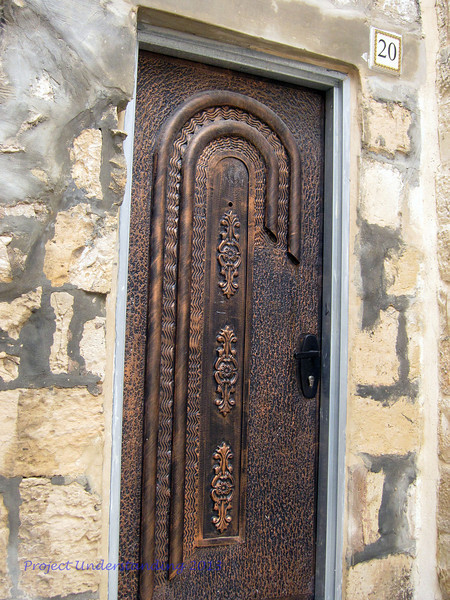 In the ancient part of the walled city you can find some beautiful modern works as well, like this door to a private home.