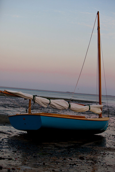 Small sail boat riding the tides.