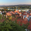 High up on the castle hill a view of Ptuj embracing both sides of the Drava River