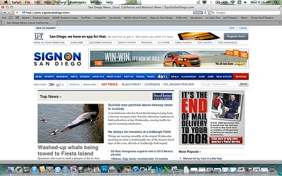 "Front page of the San Diego Union Tribune's website on the morning of 11/23/2011. To see all the pictures from this event go to the ""Animals"" link at the top of this page and scroll down to the ""Whale Tow"" gallery."