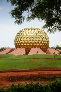 The Matrimandir is the edifice of spiritual significance for practitioners of Integral yoga, situated at the centre of Auroville initiated by The Mother of the Sri Aurobindo Ashram. It is called soul of the city and is situated in a large open space called Peace.  Matrimandir View Point, Auroville, Pudducherry, South India.