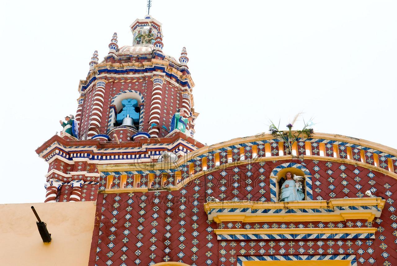 Santa Maria Tonantzintla church. Detail, showing Talavera tiles in facade.