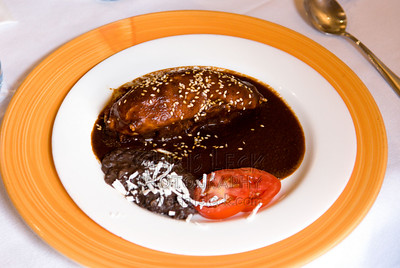 Mole Poblano served with black beans and tomato