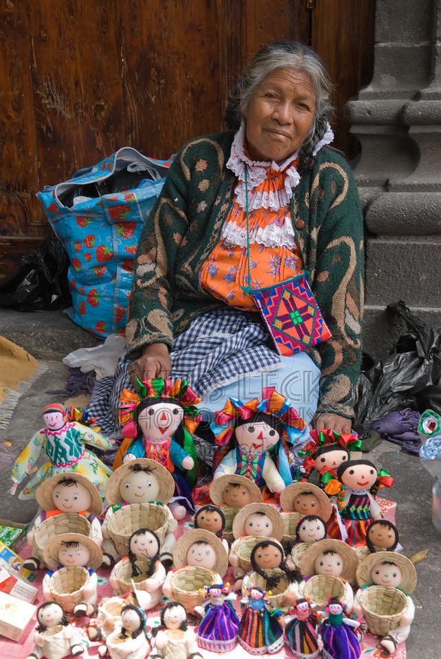 Street vendor selling dolls in Puebla