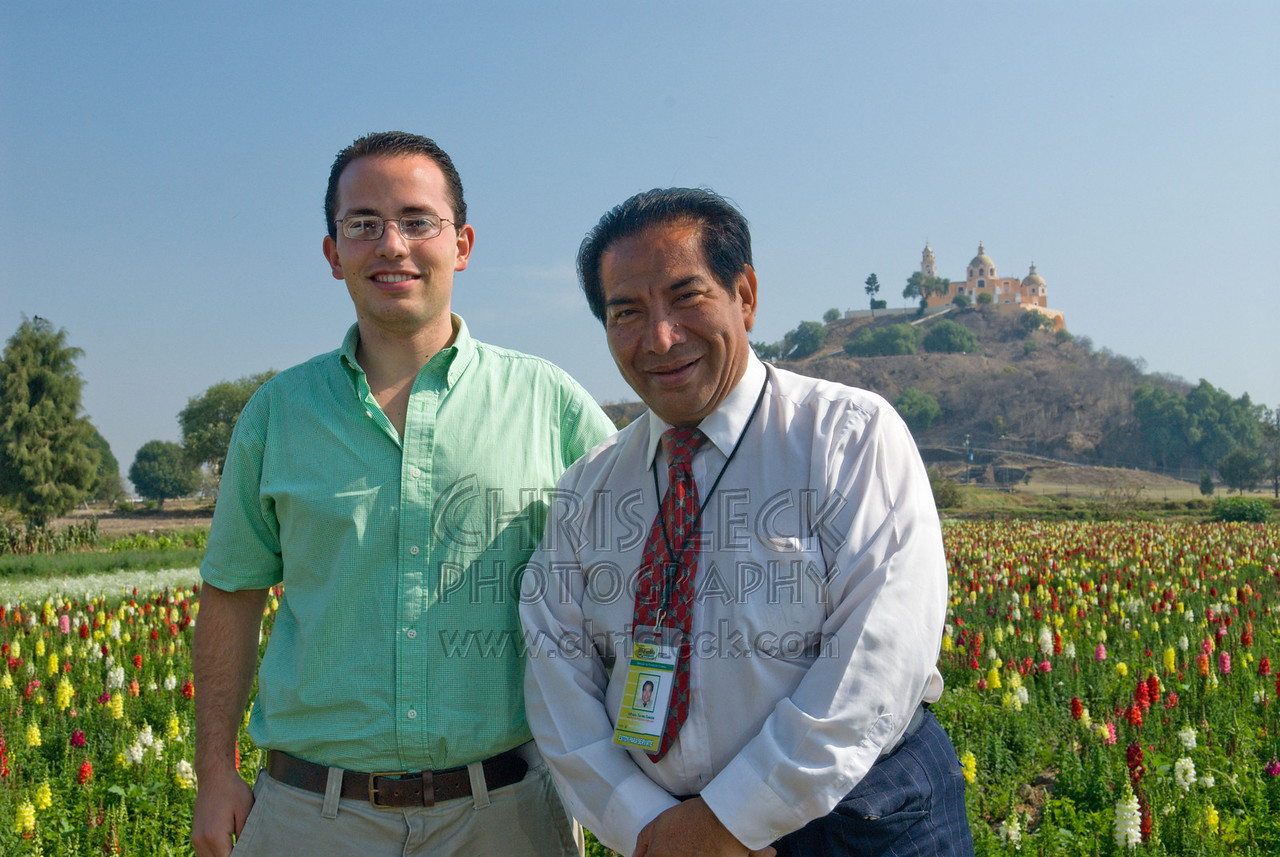 Guides Luis Hernandez (l) and Alfredo Torres Cuahite. In the rear is the Temanapa Pyramid and a field of snapdragons.
