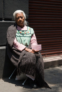 Woman begging near el zócalo, Puebla