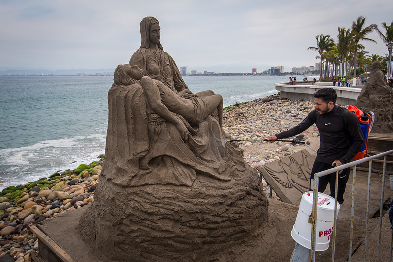Artisan keeping Sand Sculpture moist - Puerta Vallarta, Mexico -  April 2017
