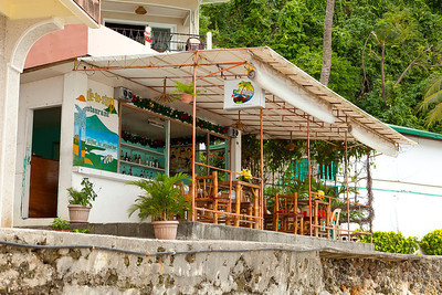 Local bar in front of waterfront hotel.