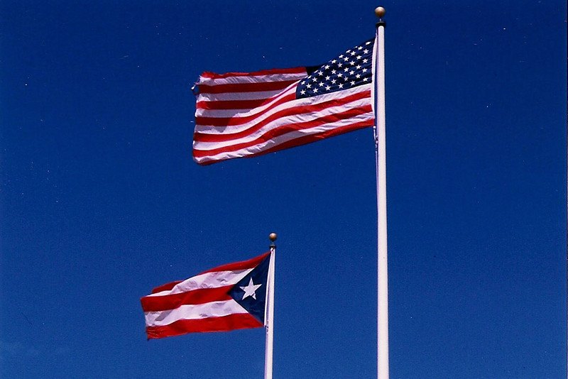 Puerto Rico is a commonwealth of the US.  PR's flag is very close to the flag of nearby Cuba but yet has components of Old Glory.