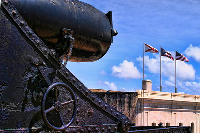Canon at the fort El Morro, Old Suan Juan, Puerto Rico. Note the flags from left to right - San Juan, Puerto Rico, USA
