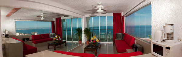 We MAY still have this 1-bedroom corner condo located just ONE block (up a BUNCH of stairs) behind the Blue/Green Chairs on Muertos Beach!!   You have sliding glass doors out onto your balcony & a wall of windows (the side on the left is a wall of mirrors giving you this WIDE OPEN FEELING!!! & is it BRIGHT!!!).  This building is Straight-Friendly meaning this time of year - about 98% gay!!!  Details coming in the a.m.  IF this is still available - it's ONLY available TILL/checking out on Dec. 30.