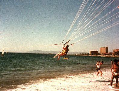"Vicki Skinner (aka ""Vallarta Vicki"") Parasailing on her first trip to Puerto Vallarta, Mexico - around 1982-ish - with Terrye Hoffman, Jeff Hayne & Laurant Wolman"