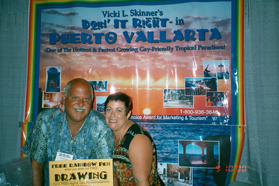 "Vicki Skinner (aka ""Vallarta Vicki"") with Doin it Right in Puerto Vallarta, Mexico with client Tom at booth at the Gay Travel Expo in New York"