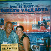 """Vicki Skinner (aka """"Vallarta Vicki"""") with Doin it Right in Puerto Vallarta, Mexico with client Tom at booth at the Gay Travel Expo in New York"""