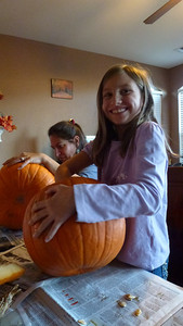 Ashley cleaning all the guts out of her pumpkin.