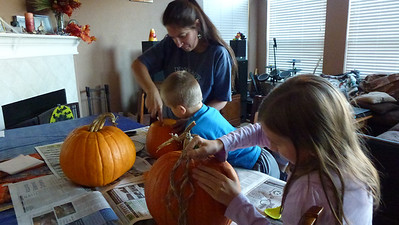 Debbie, Matt and Ashley preparing their pumpkins.