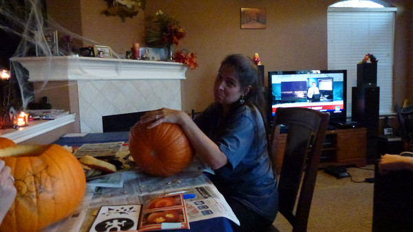 Deb still cleaning out the pumpkins.