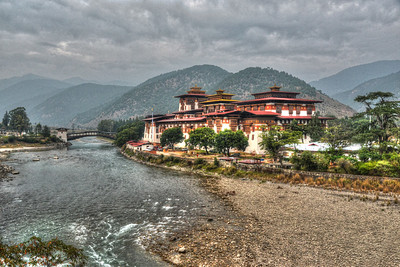 "Tonemapped image of The Punakha Dzong, also known as Pungtang Dechen Photrang Dzong (which means ""the palace of great happiness or bliss""), is the administrative centre of Punakha District in Punakha, Bhutan."