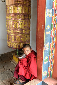 Monks at the Temple of Fertility (Chimi L'hakhang Temple), Punakha, Bhutan.