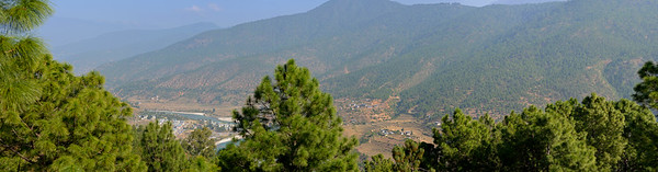 Panoramic view of at Punakha, Bhutan from the balcony (sit out area) of our room in Hotel Dhensa. Dhensa Boutique Resorts opened its first resort in Bhutan's Punakha Valley in March 2014. Dhensa Resort is a boutique property, located in the heart of Bhutan's verdant and lush Punakha Valley. Flanked by thick pine forests, it overlooks the Punakha River and is surrounded by several walking and trekking trails.