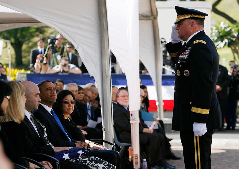 General Francis Wiercinski salutes Daniel Ken Inouye Jr., as President Obama looks on, at Senator Inouye's Punchbowl service on December 23, 2012. (REUTERS/Hugh Gentry).